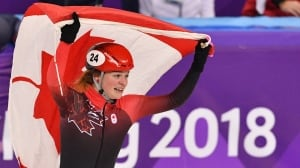 Who will carry Canada's flag in the closing ceremony?