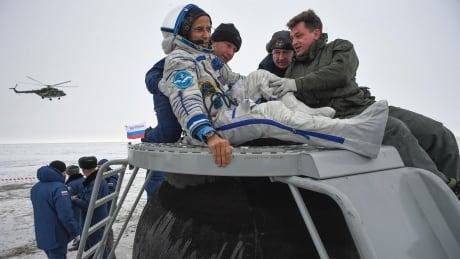 Astronauts, cosmonaut touch down on Earth after months at Space Station