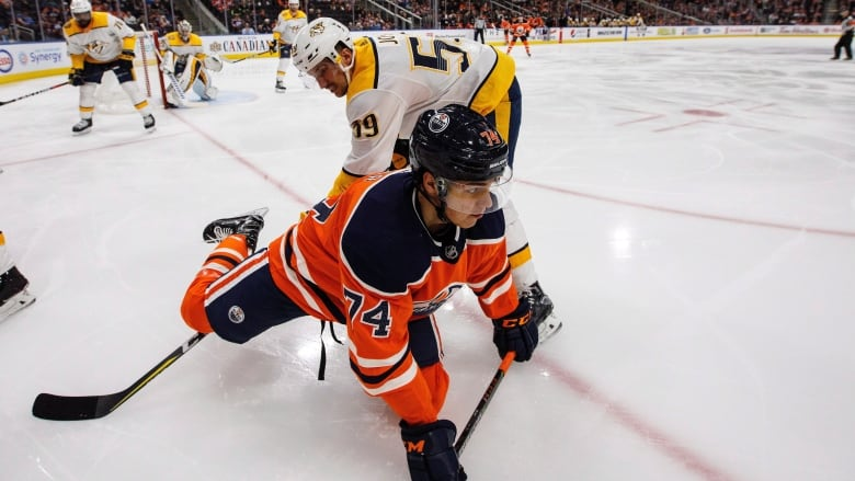 Nashville Predators  Roman Josi (59) trips up Edmonton Oilers  Ethan Bear  (74) during second period NHL action at Rogers Place on Thursday. 000fd5bcd