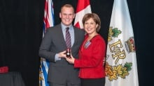 Luke Strimbold, former mayor of Burns Lake, B.C. with Christy Clark