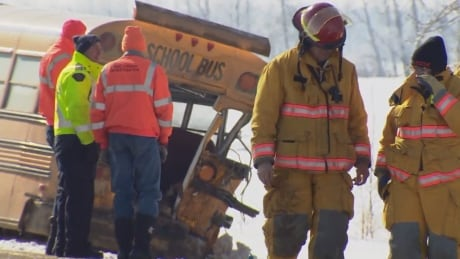 Teenage girl killed when school bus rear-ended by gravel truck north of Redwater