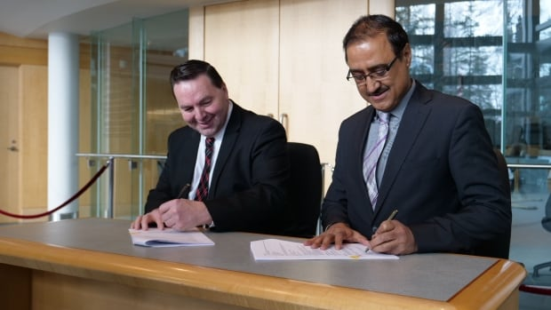 N.W.T. Infrastructure Minister Wally Schumann, left, and federal Minister of Infrastructure and Communities Amarjeet Sohi signed a bilateral agreement at the N.W.T. Legislative Assembly on Wednesday that makes $570 million in infrastructure funding available to the territory over the next 10 years.