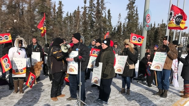 Union of Northern Workers president Todd Parsons speaks to the crowd at the N.W.T. Legislative Assembly on Friday.