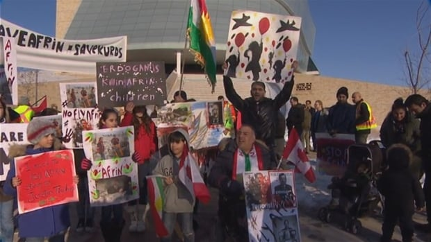 Dozens of protesters demonstrated outside the CMHR Sunday to denounce escalating violence in Syria