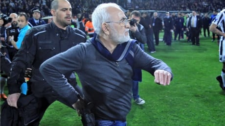 Greece suspends soccer league after team owner marches onto field with gun to protest call