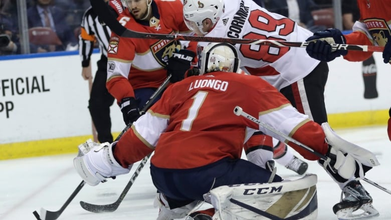 e6c374e4bf5 Ottawa s Max McCormick attempts a shot on goalie Roberto Luongo during the  Senators  5-3 win over the Florida Panthers on Monday.