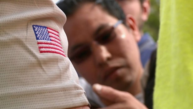 Many undocumented migrants say they're in the middle of the latest war between D.C. and California.