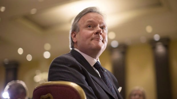 Bank of Canada Governor Stephen Poloz says Ottawa's accumulation of public debt may be restraining the growth of private debt. THE CANADIAN PRESS/Chris Young
