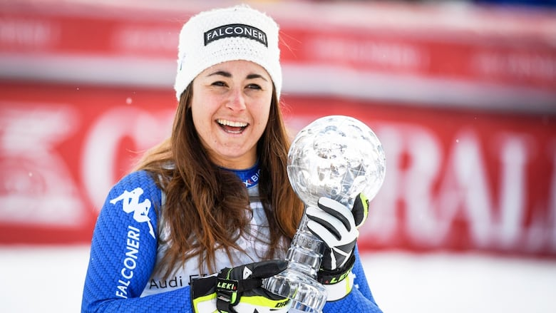 Sofia Goggia Of Italy Celebrates With The Crystal Globe After Taking The Overall World Cup Downhill Title In Are Sweden On Wednesday