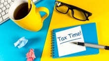 tax time coffee glasses pen notepad