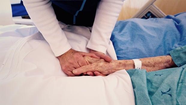 Hospital volunteer cares for patient Hildegard Pietsch