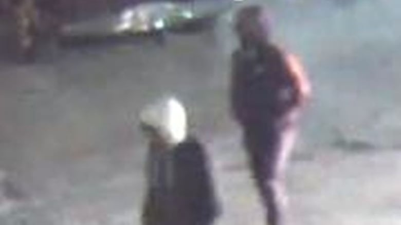 Toronto police have released security camera video and photos of two  suspects in the fatal shooting of a man described by police as 'innocent' on  Friday ...