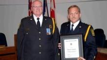former Saint John police chief Bill Reid, left, with former deputy Bruce Connell
