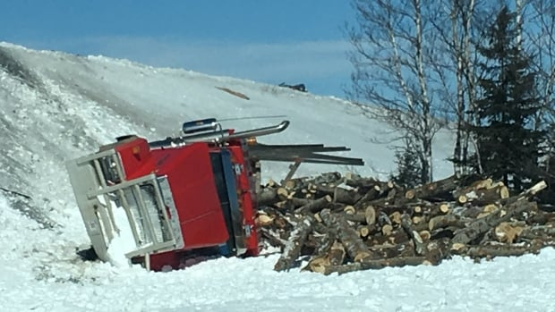 RCMP say the driver of the transport truck went down an enbankment, stopping about 20 feet (about six metres) from a nearby road after being involved in a three-vehicle crash.