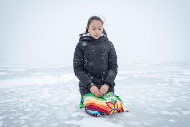 Autumn Peltier Water Walker kneeling on the ice
