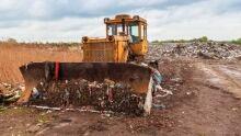 Garbage dump bulldozer