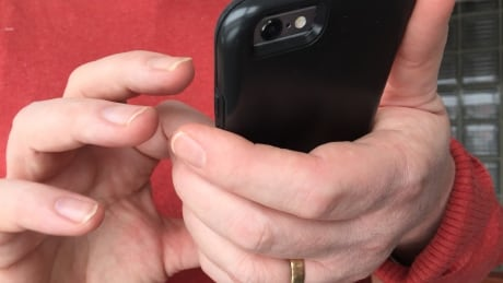 Male hand on smart phone