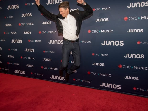 Vancouver Mayor Gregor Robertson shows off his inner rockstar on the red carpet during arrivals for