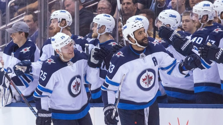 Dustin Byfuglien, right, had a goal in the Winnipeg Jets' 3-1 win over the  Toronto Maple Leafs on Saturday night. (Chris Young/Canadian Press)