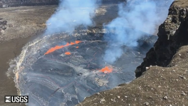 Mount Kilauea sputtering lava from summit lake
