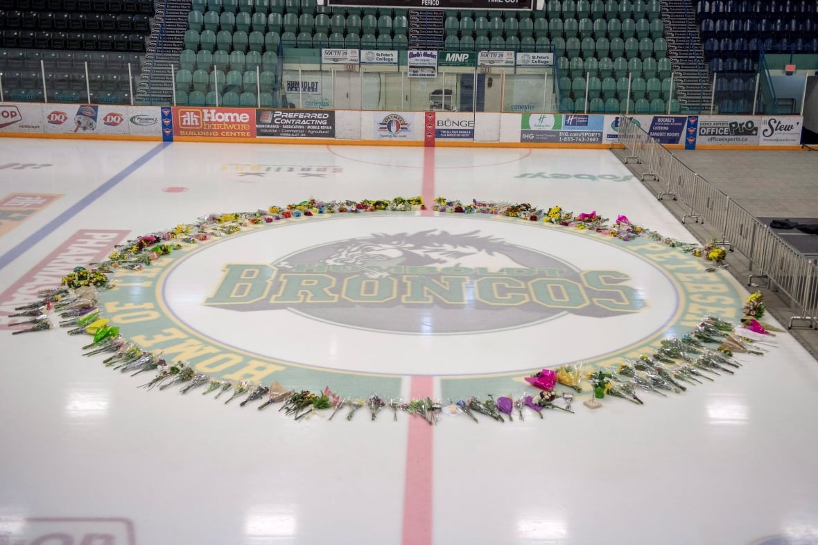 A ring of flowers surround centre ice at Elgar Petersen Arena in Humboldt