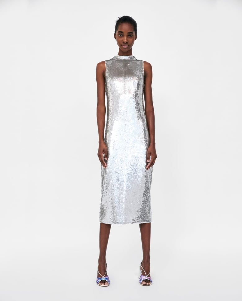 a01c4292af5 This shimmering sheath would be perfect for glam wedding. The A-line cut  and just-past-the-knee length is flattering to many figures