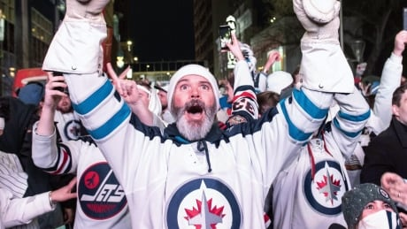 Winnipeg Jets fans celebrate their team's Game 1 win over the Minnesota Wild.