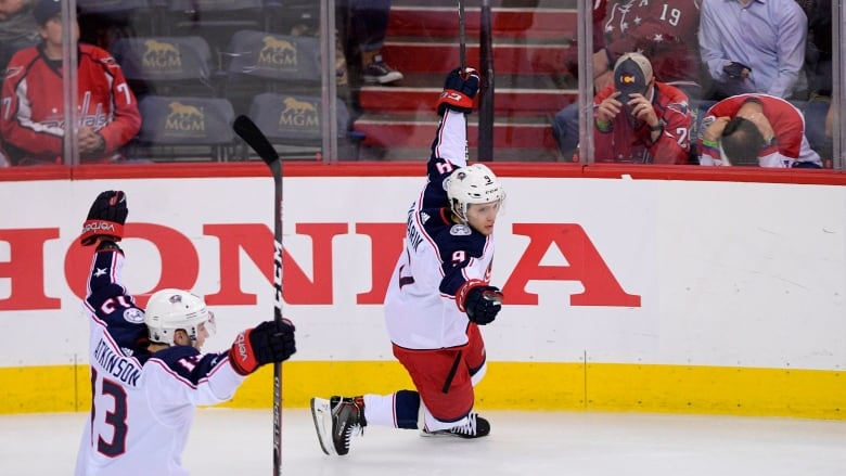 Columbus  Artemi Panarin celebrates his game-winning goal with Cam Atkinson  during overtime of the Blue Jackets  4-3 win in Game 1 against the  Washington ... 8f9ddd1f5d34
