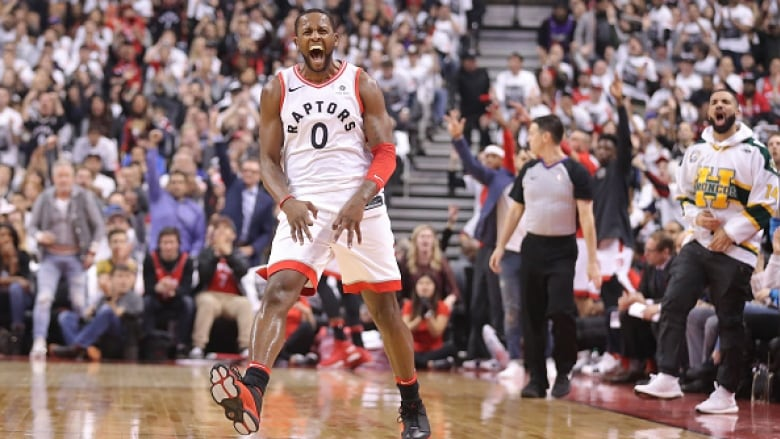C.J. Miles celebrates a first-quarter three-pointer during the Toronto  Raptors  114-106 Game 1 victory over the Washington Wizards on Saturday. 3e8199988