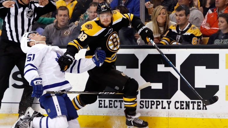 Boston s David Pastrnak carries the puck past Toronto s Jake Gardiner  during the second period of the Bruins  7-3 Game 2 victory over the Maple  Leafs on ... 5e1832bd4