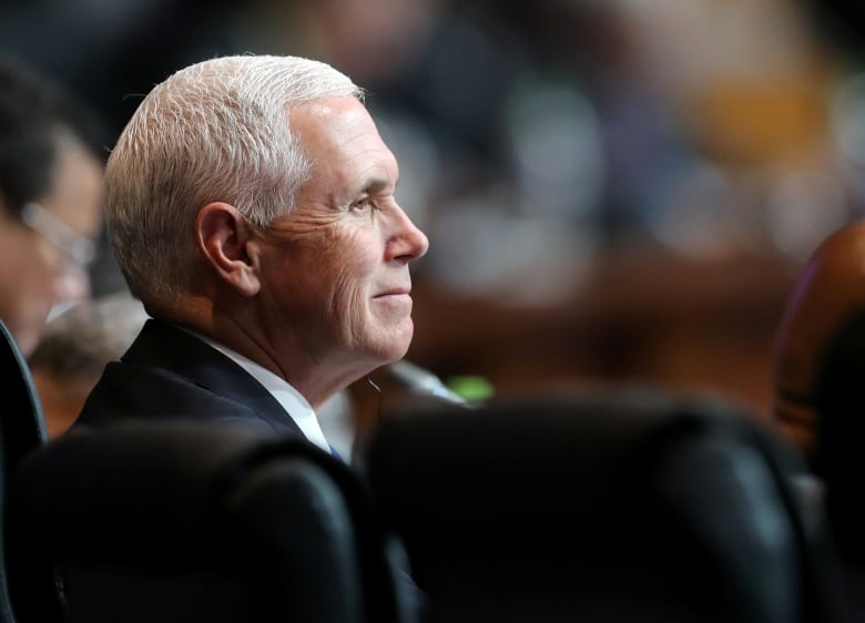 U.S. Vice President Mike Pence would become president if Trump is impeached or leaves office before the end of his term. Pence would have the power to pardon Trump.(Andres Stapff/Reuters)