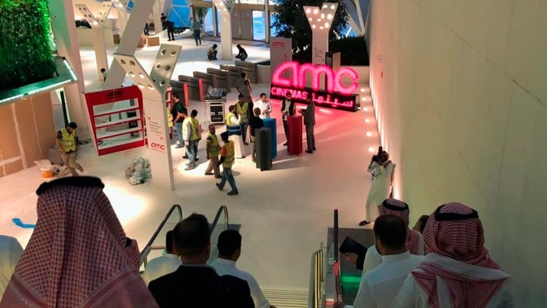 Saudi arabias 35 year cinema ban ends today with black panther people gather at the king abdullah financial district theatre in riyadh a day ahead of the first public screening of a commercial film after a wave of malvernweather Image collections