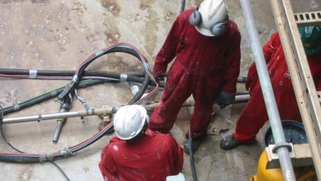 Workers check pipes Nigeria