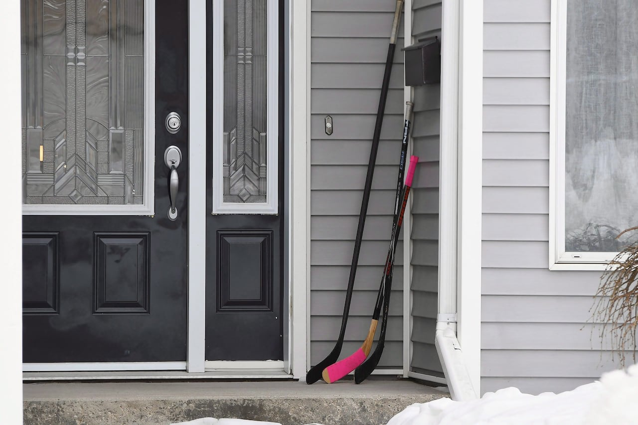 1bdb526d9bb Town puts  giant hockey stick on our porch  in Humboldt tribute ...
