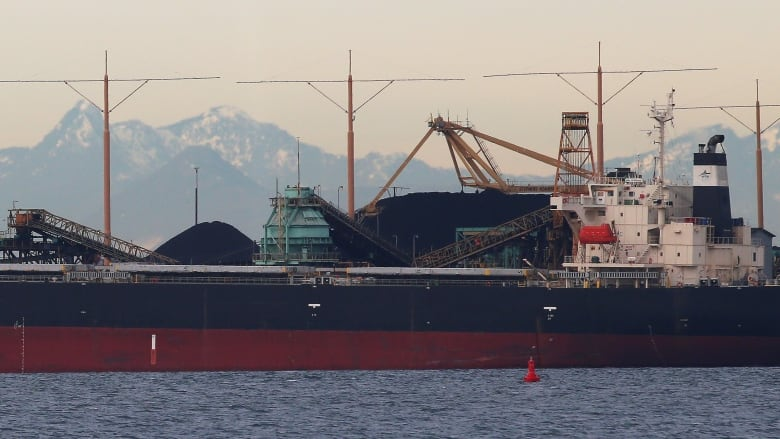 A ship loads coal in British Columbia. A surge in oil demand and growing  exports of coal to Asia mean the world's carbon output has begun to grow  again.