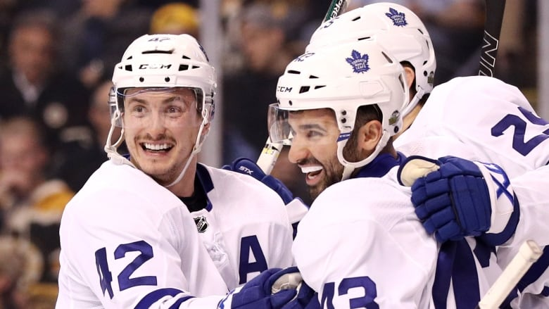 Tyler Bozak, left, had two points as the Toronto Maple Leafs escaped Boston  with a 4-3 victory on Saturday evening. (Maddie Meyer/Getty Images)