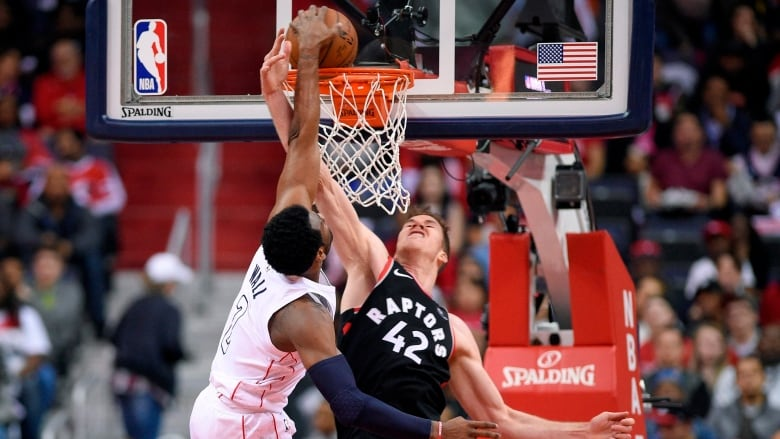 Washingtons John Wall Dunks On Torontos Jakob Poeltl In The First Half Of Wizards 106 98 Win Over Raptors Game 4 Sunday