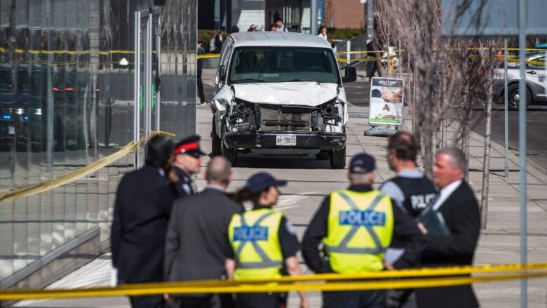 Police gather after a van driver rammed pedestrians on Monday in north  Toronto. (Aaron Vincent Elkaim/Canadian Press)