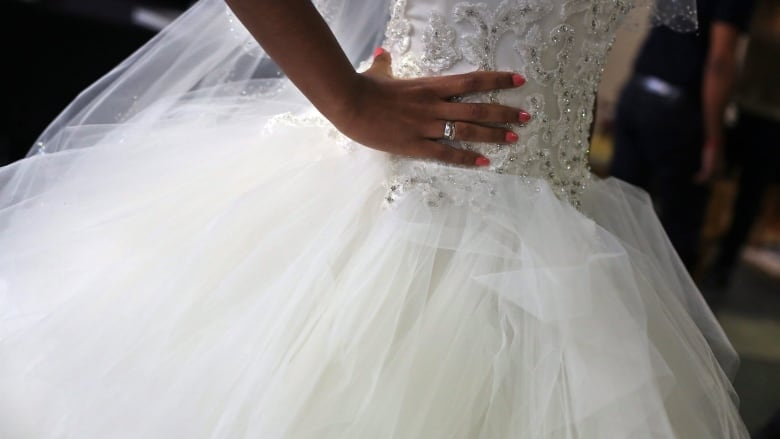 No Happily Ever After At Regina Bridal And Consignment Shop As Woman