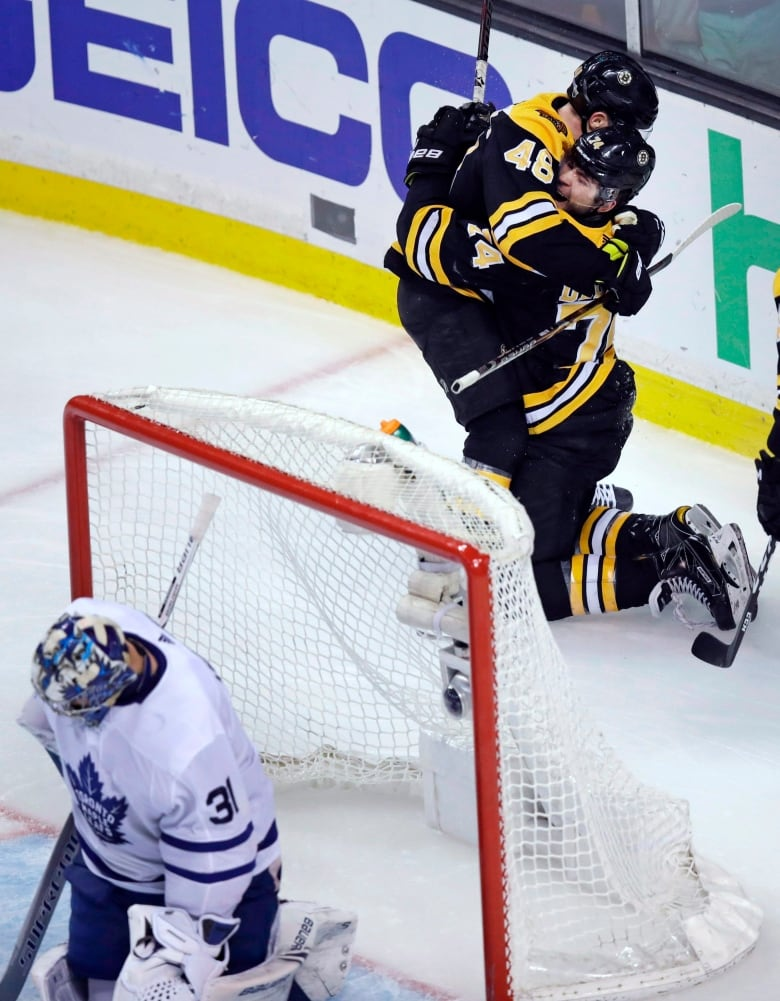bc3a81517d4 Boston Bruins left wing Jake DeBrusk is embraced by David Krejci (46) after  his goal against Toronto Maple Leafs goaltender Frederik Andersen (31)  during ...
