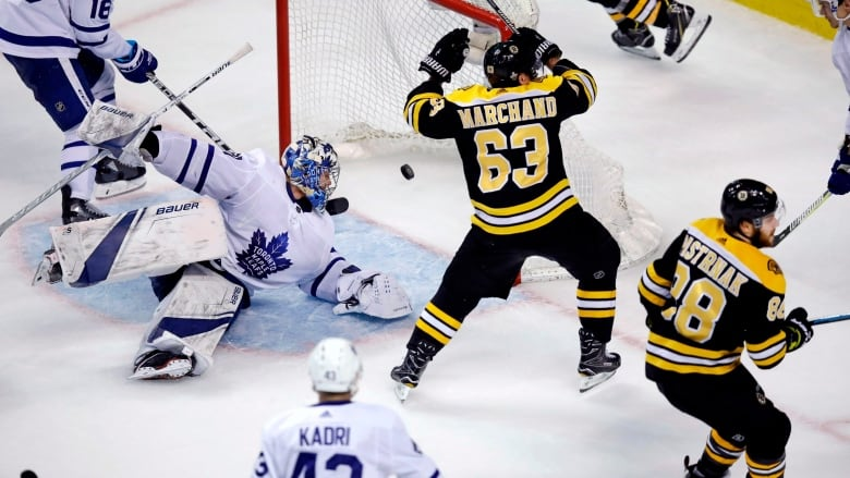 dc361743c10 Toronto Maple Leafs goaltender Frederik Andersen looks back as the puck  bounces to the back of the net on a goal by Boston Bruins right wing David  Pastrnak ...