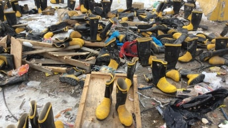 Hundreds of 'perfectly good boots' trashed at Yellowknife dump, people snatch them up