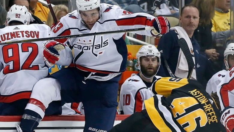 Capitals tough guy Tom Wilson collides with Penguins forward Zach  Aston-Reese during the second period in Game 3 of their Eastern Conference  semifinal on ... 7b5be9e88975