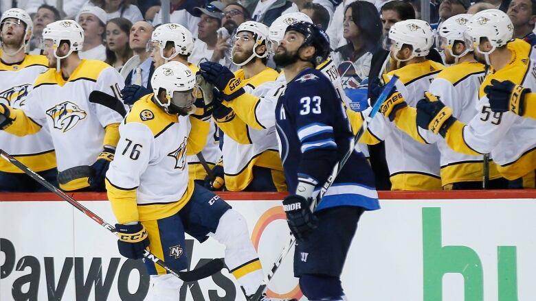 Winnipeg s Dustin Byfuglien looks skyward as Nashville s P.K. Subban  celebrates his second-period goal in the Predators  series-tying win over  the Jets on ... db92ce3e1