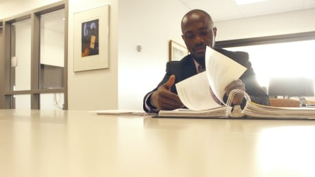 Duahn in Haskayne school of business student lounge, doing schoolwork. Photo by Kemi Omorogbe.