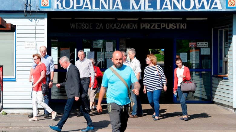 Rescue workers race to save 5 missing coal miners in Poland