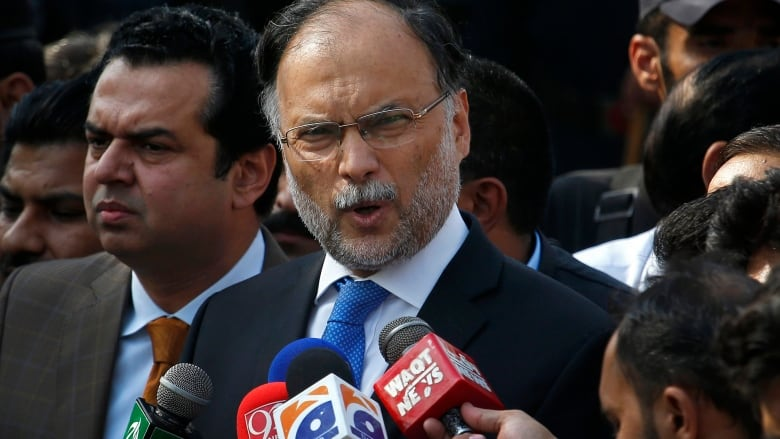 Pakistan's Interior Minister Ahsan Iqbal injured in gun attack in Punjab province