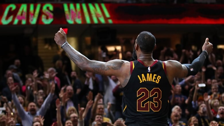 db0d6c6050 LeBron James celebrates after hitting the game-winning shot in Game 3 to  give the Cleveland Cavaliers a 3-0 series lead over the Toronto Raptors. ( Gregory ...