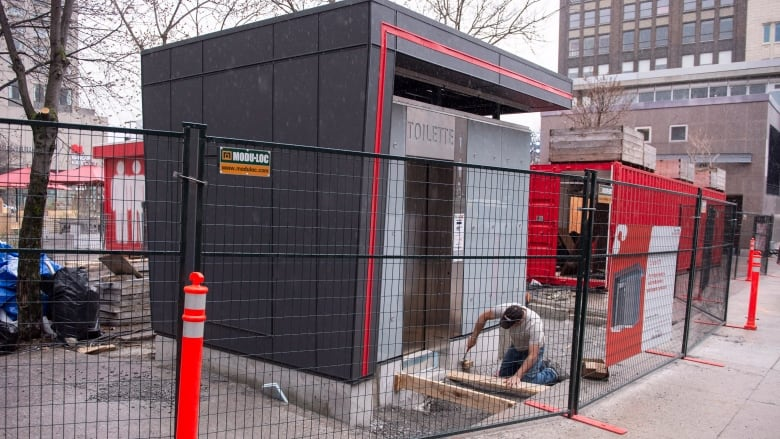 A Worker Puts The Finishing Touches On A New Public Toilet In Montreal One Of The Of A Planned  High Tech Self Cleaning Free To Use Public Bathrooms