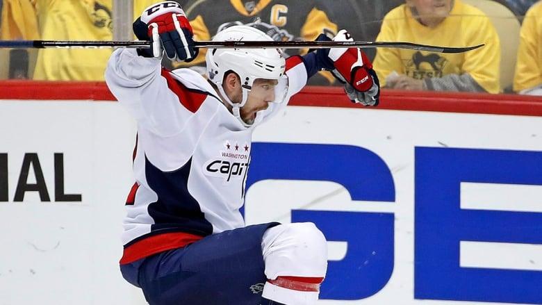 Capitals forward Evgeny Kuznetsov celebrates after scoring the  series-winning goal against the Penguins in overtime of Game 6. (Gene J.  Puskar Associated ... 6de2a0e9a0ff